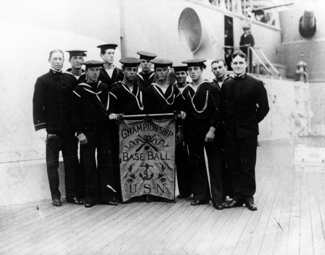 Members of the ship's championship baseball team proudly display their award, circa 1907. (Naval History & Heritage Command Photograph NH 95329, courtesy of Paul E. Lorms, 1984)