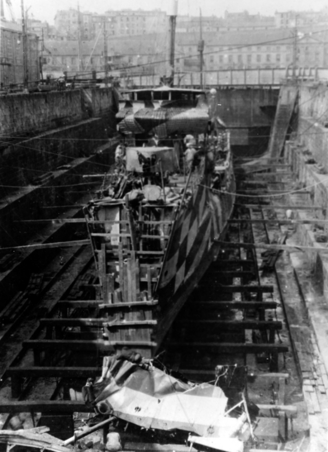 Jarvis on 22 July 1918 at Brest, France in drydock after her collision with Benham (Destroyer No. 49). The wreckage of her bow was cut away by a repair crew from Prometheus (Repair Ship No. 2). Upon completion of temporary repairs, Jarvis went to Birkenhead, England, where permanent repairs were completed in September 1918. (Naval History and Heritage Command Photograph NH 64983)