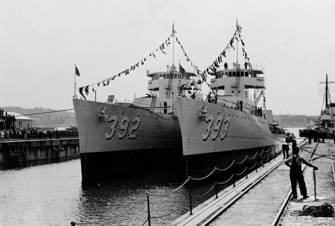 Colorfully dressed Patterson (left) and Jarvis leave the building dock at Puget Sound the day after their christening, 7 May 1937. (Naval History and Heritage Command Photograph NH 63389)