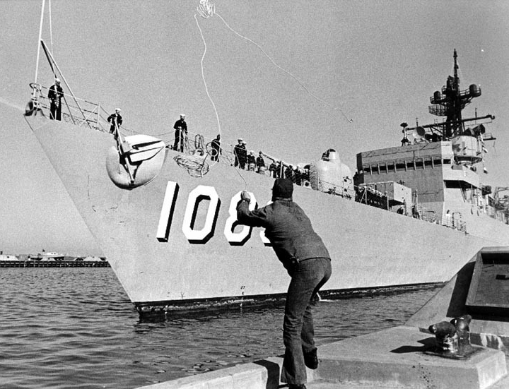 Jesse L. Brown ties up at Charleston as she returns from a Mediterranean deployment, 6 December 1974. (U.S. Navy Photograph, PH1 Milt Putnam, Naval History and Heritage Command Photograph NH 96768)