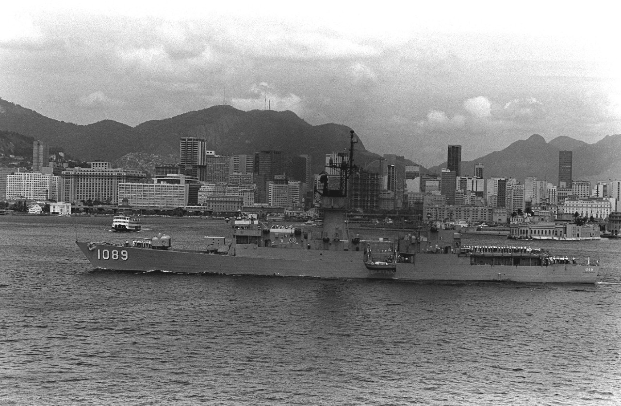 Jesse L. Brown passes the skyline of Rio de Janeiro during Unitas XX. (U.S. Navy Photograph SN-82-09756, PH2 J. Vinson, National Archives and Records Administration, Still Pictures Division, College Park, Md.)
