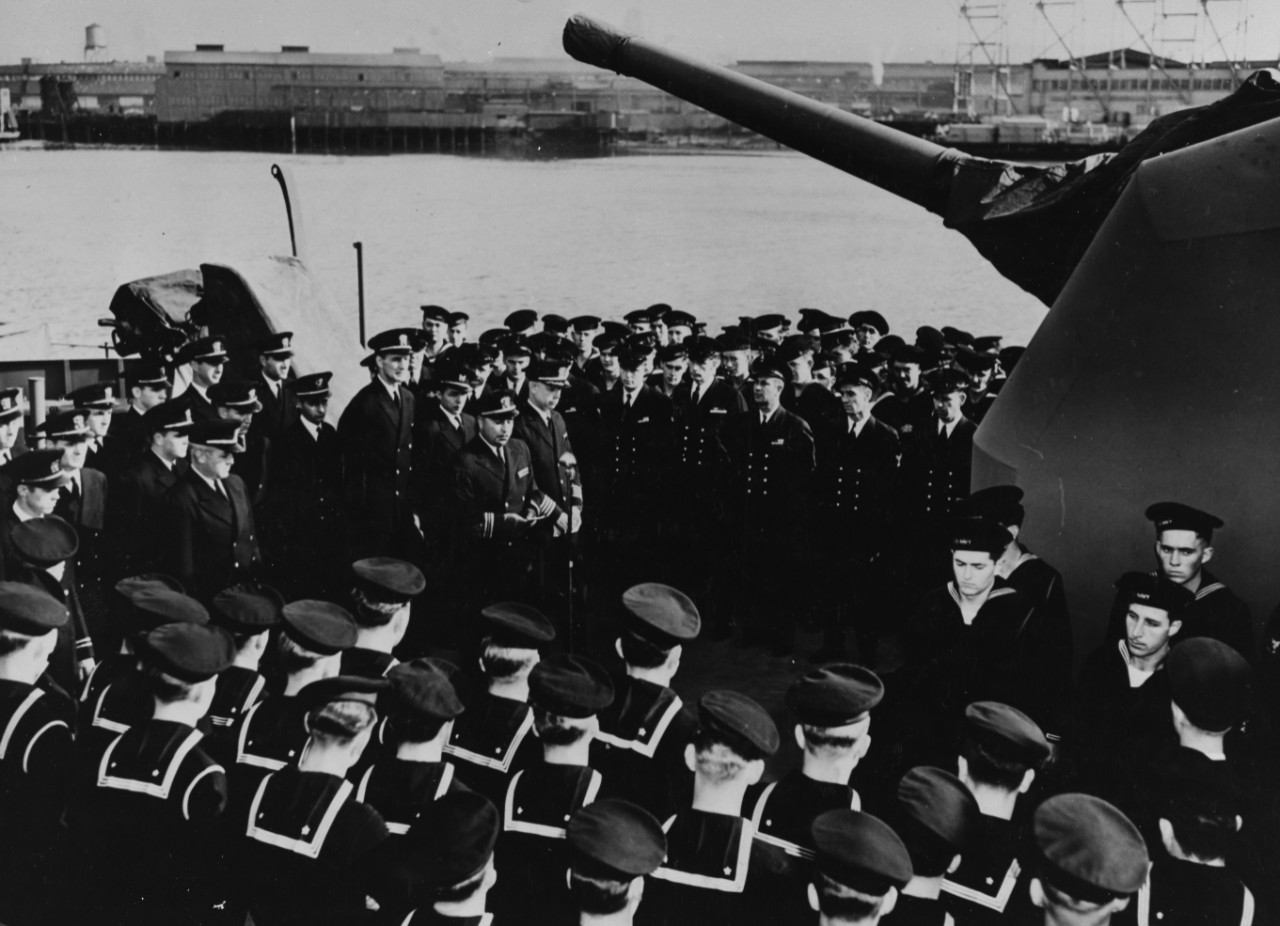 Lt. Cmdr. Ernest E. Evans addresses Johnston's officers and men at her commissioning, 27 October 1943. (Naval History and Heritage Command Photograph NH 63368)