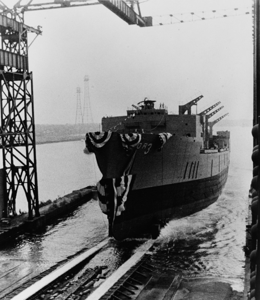 Kansas City slides down the ways at her christening at General Dynamics, Quincy, Mass., 28 June 1969. (Naval History and Heritage Command Photograph USN 1143691)