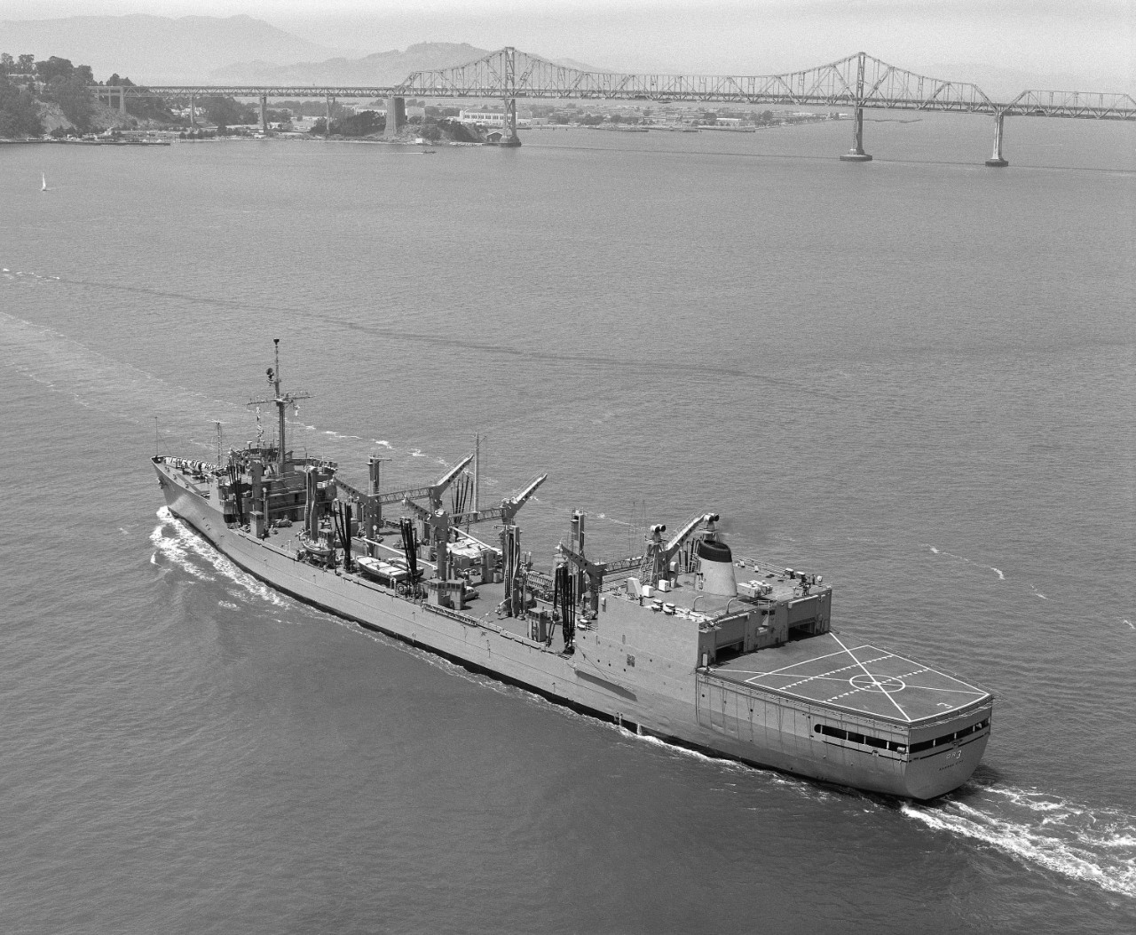 Kansas City underway in San Francisco Bay with the San Francisco-Oakland Bay Bridge in the background, August 1984. (U.S. Navy Photograph DN-SN-84-10221, National Archives and Records Administration, Still Pictures Division, College Park, Md.)