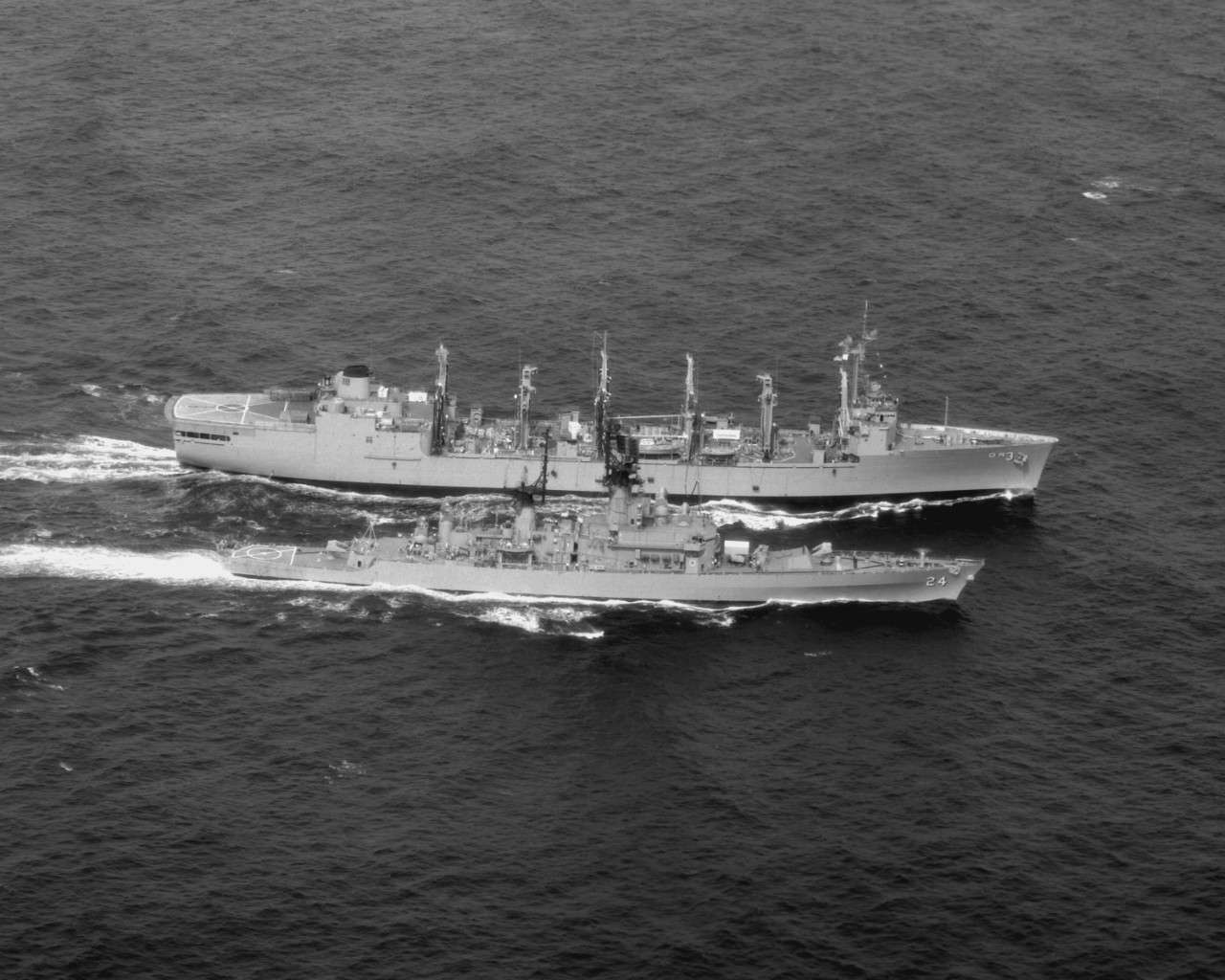 Guided missile frigate Reeves (DLG-24) steams alongside Kansas City during underway replenishment operations, 1975. (U.S. Navy Photograph DN-SN-93-01364, National Archives and Records Administration, Still Pictures Division, College Park, Md.)