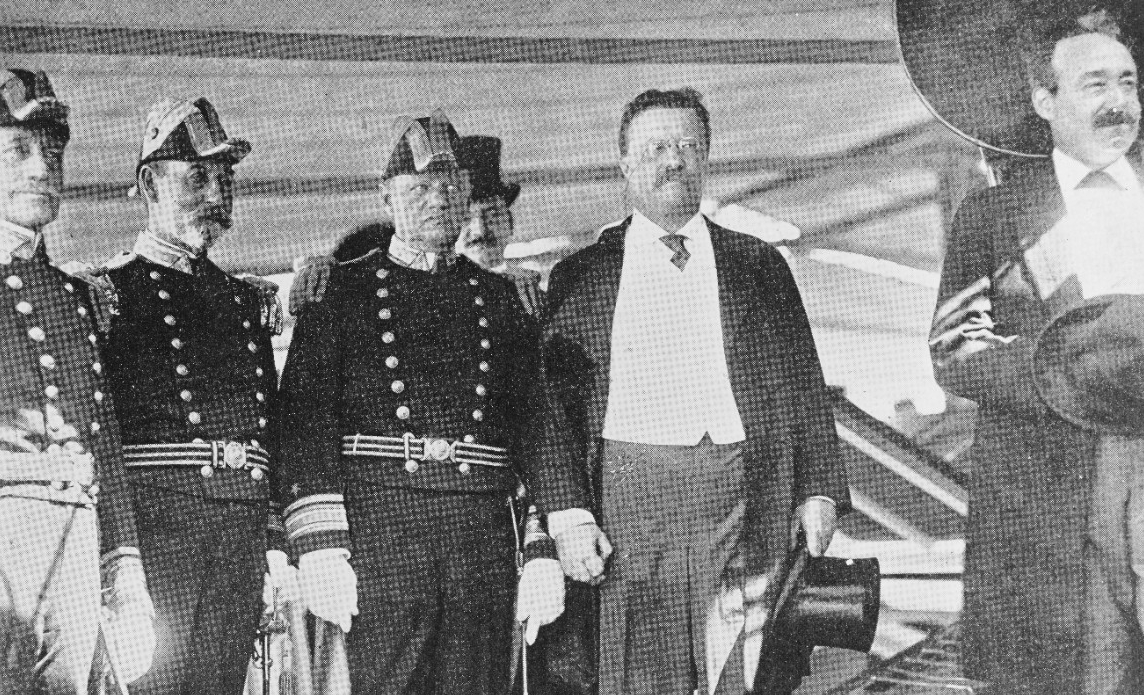 President Roosevelt (second from right) reviews the Atlantic Fleet from on board Mayflower off Oyster Bay, N.Y., on Labor Day 1906. With him are (left to left center): Rear Adm. Willard H. Brownson, Commander, Fourth Division; Rear Adm. Charles H. Davis, Commander, Second Division; and Rear Adm. Robley D. Evans, Commander, Atlantic Fleet. At right is Secretary of the Navy Charles J. Bonaparte. (Naval History and Heritage Command Photograph NH 1203)
