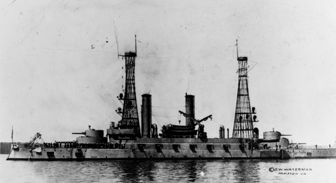 A wartime view of Kentucky at Hampton Roads, circa 1918. Note the distinctive cage masts, and that most of her original 5-inch guns have been removed, leaving only four per side. (Naval History and Heritage Command Photograph NH 80744)