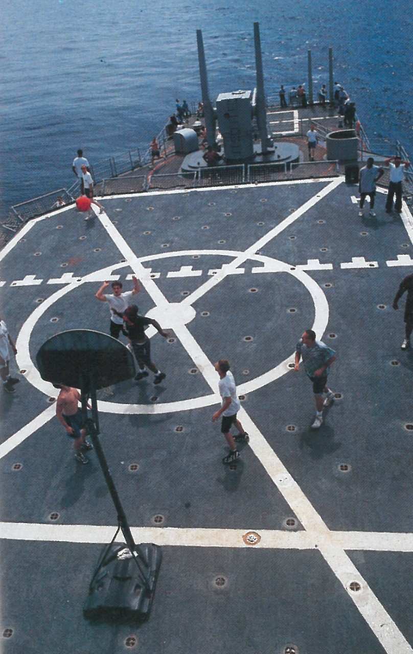 Kidd's crew indulges in a most dangerous game on the ship's deck.  (Kidd's 1996 Cruise Book)