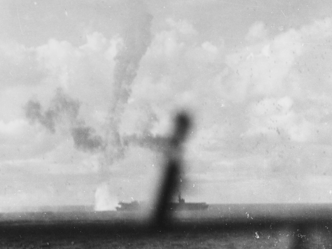 A fiery trail marks a Japanese plane's final plunge into the sea just astern of Kitkun Bay, 18 June 1944. (U.S. Navy Photograph 80-G-243432, National Archives and Records Administration, Still Pictures Division, College Park, Md.)