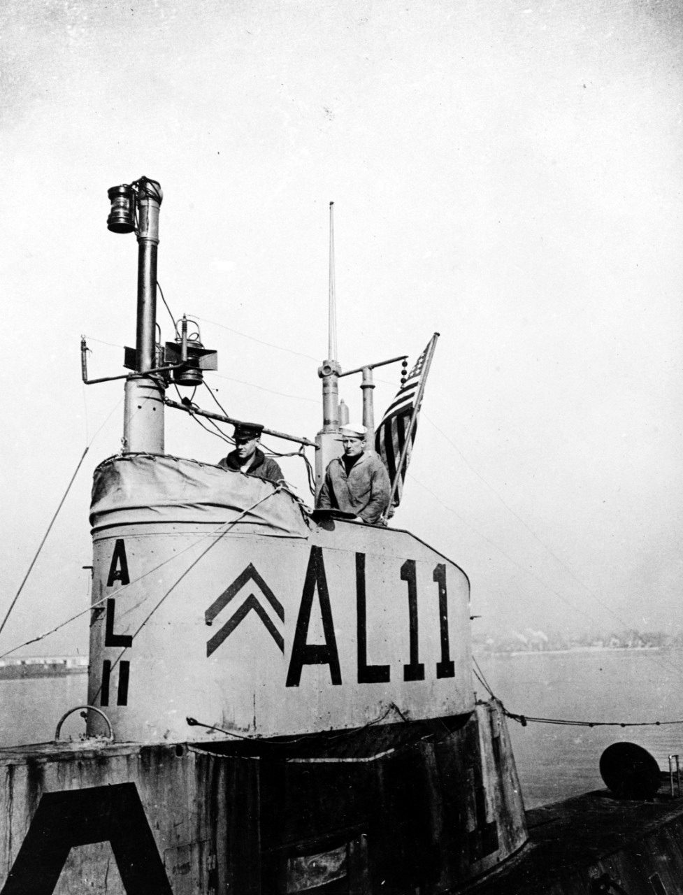 "Close-up view of L-11's conning tower taken at the Philadelphia Navy Yard in 1919. Note the overseas service chevrons painted adjacent to her ""AL11"" identifier. (Naval History and Heritage Command Photograph NH 51180)"