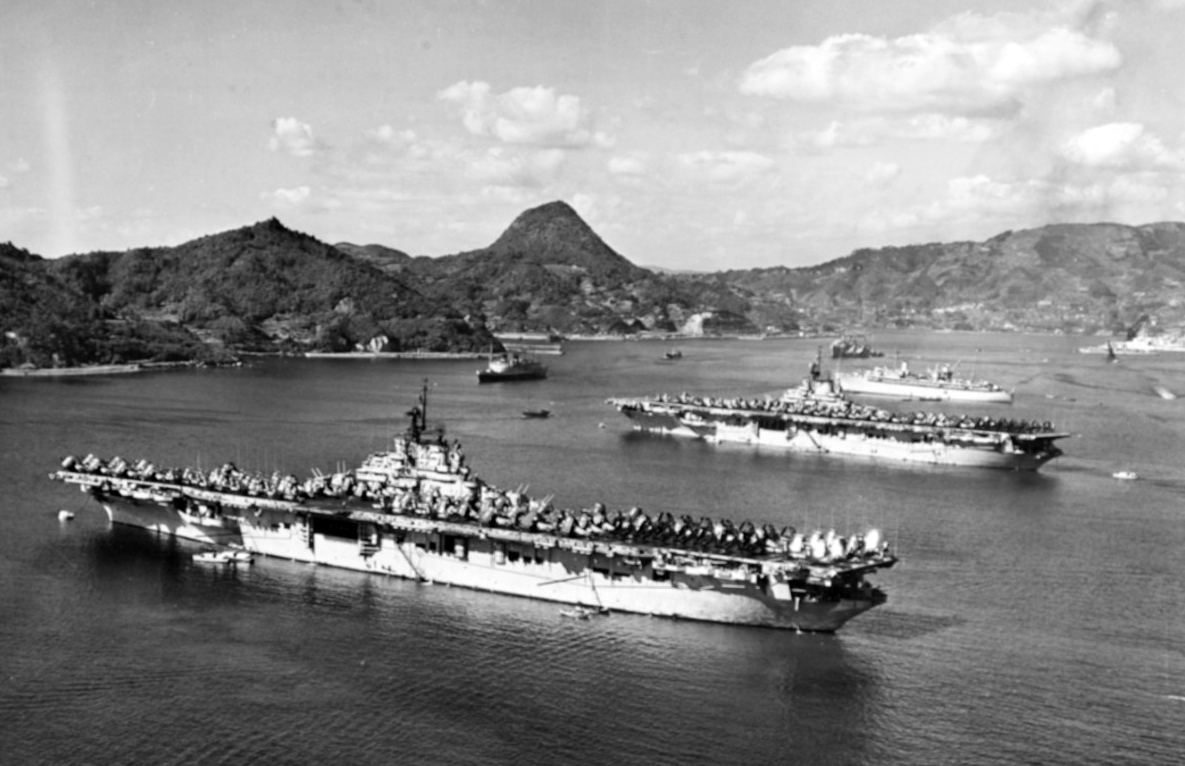 Valley Forge (CV-45) and Leyte moored at Sasebo, Japan, in October 1950. Repair ship Hector (AR-7) lies moored beyond the two carriers, with other U.S. and British warships in the distance. (U.S. Navy Photograph 80-G-426270, National Archives and Records Administration, Still Pictures Division, College Park, Md.)