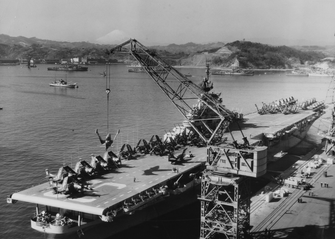 Leyte loading aircraft at Yokosuka for transportation to the U.S., at the end of her Korean War combat tour, 24 January 1951. (Naval History and Heritage Command Photograph NH 97295)