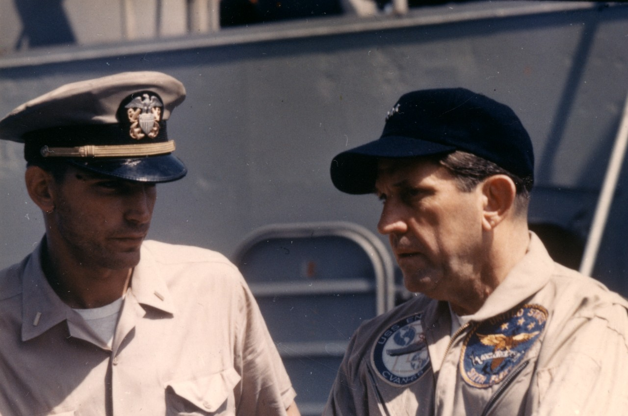 Ens. David G. Lucas, USNR, unshaven and bearing the scars of battle (L) and a grim and concerned Vice Adm. William I. Martin, Commander Sixth Fleet, on board Liberty, 9 June 1967, as photographed by PH1 J. J. Kelly. (U.S. Navy Photo, National Archives and Records Administration, Still Pictures Section, College Park, Md.)