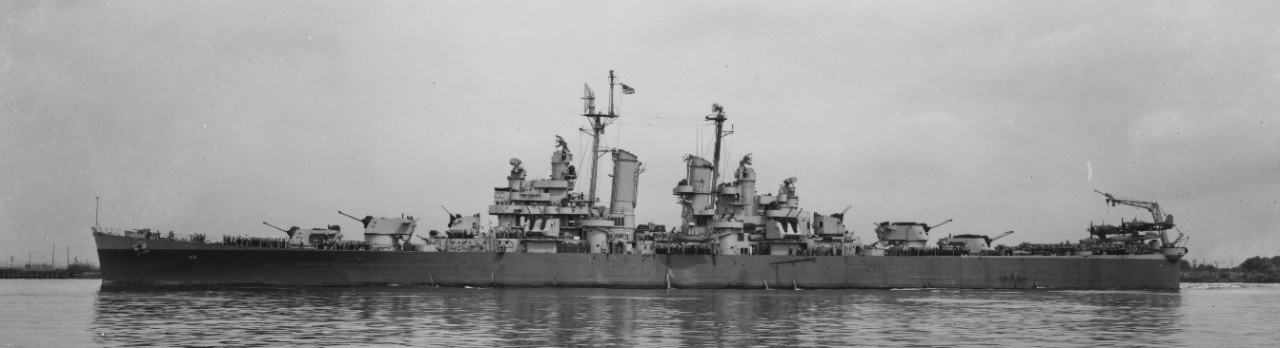 Little Rock off the Philadelphia Navy Yard, 1945, with her crew at quarters and two Curtiss SC-1 Seahawks on her catapults aft. (U.S. Navy Bureau of Ships Photograph 19-N-92423, National Archives and Records Administration, Still Pictures Division, College Park, Md.)