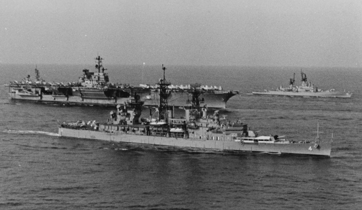 Little Rock steaming with Saratoga (CV-60) and other Sixth Fleet units en route Gaeta, 16 March 1976. (Naval History and Heritage Command Photograph NH 98962)