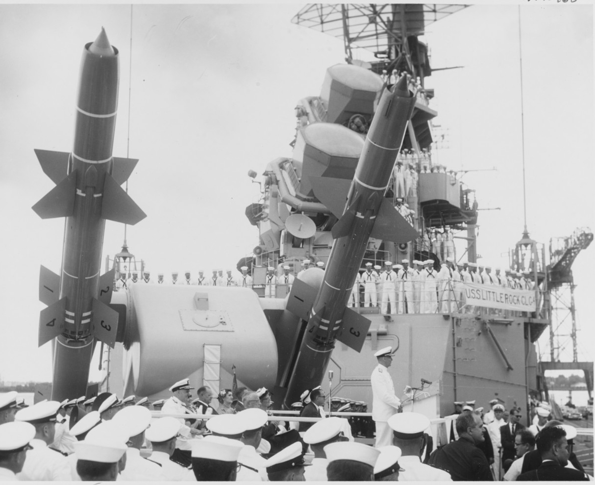 Rear Adm. Charles H. Lyman speaking during the ship's commissioning ceremonies, at the Philadelphia Naval Shipyard, 3 June 1960. Note Talos guided missiles behind the speaker's platform. (Naval History and Heritage Command Photograph NH 98963)