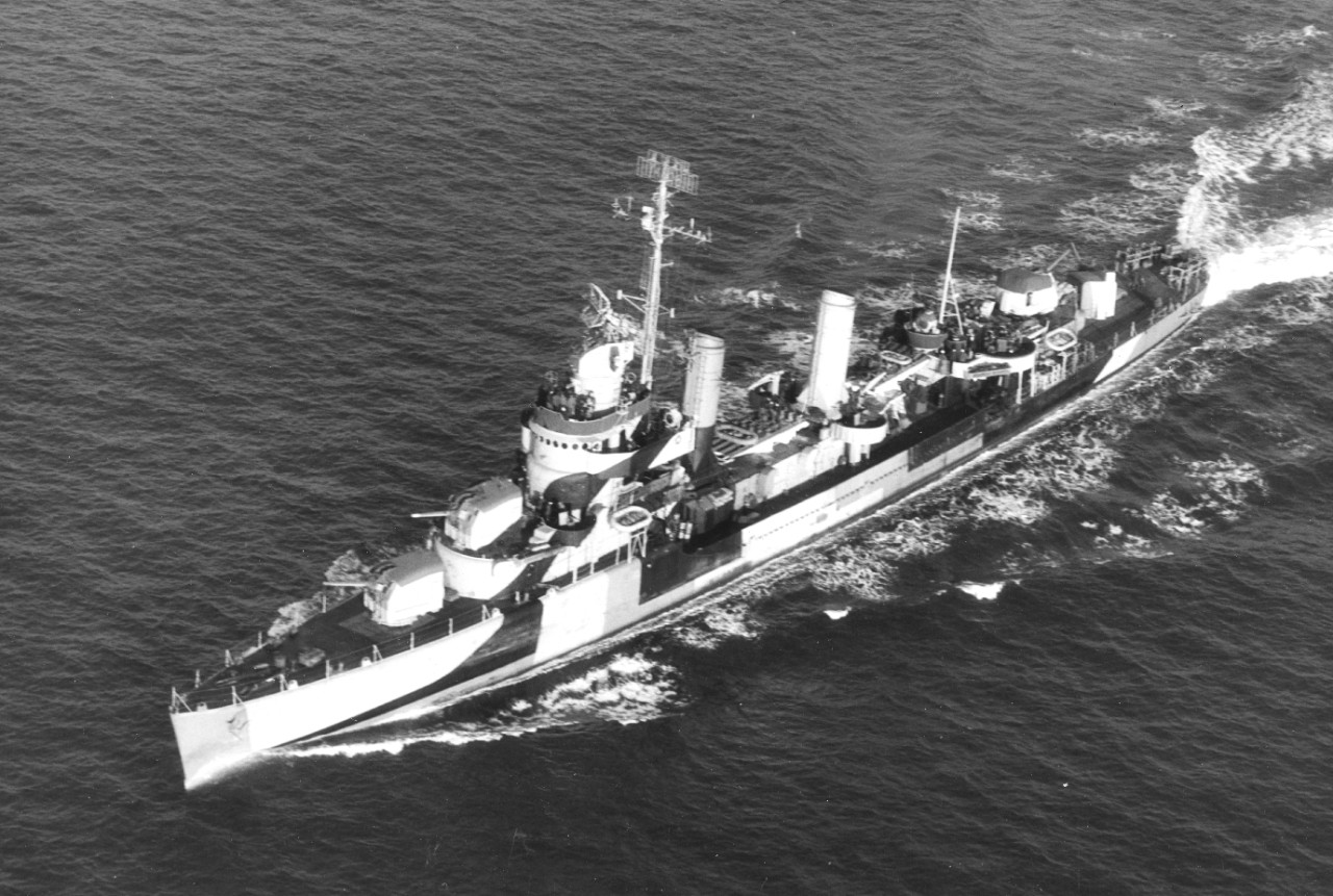 Livermore at sea, 7 December 1944, in pattern camouflage, with Mt. 51 and Mt. 52 trained slightly to starboard, as is the Mk. 37 director; stub mast aft supports high-frequency direction finder (HF/DF) antenna. (U.S. Navy Photograph 80-G-290565, National Archives and Records Administration, Still Pictures Division, College Park, Md.)