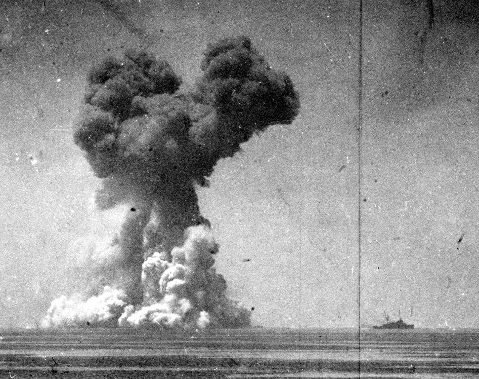 Lt. Sutton continues to take pictures, as the mushroom cloud from the explosion travels upward, dwarfing Longshaw and Arikara. (U.S. Navy Photograph 80-G-343582, National Archives and Records Administration, Still Pictures Division, College Park, Md,)