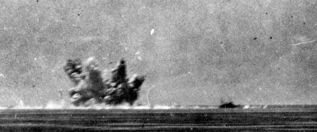 Longshaw's forward magazine explodes, photographed by Lt. Sutton from his vantage point on board Vincennes. (U.S. Navy Photograph 80-G-333688, National Archives and Records Administration, Still Pictures Division, College Park, Md,)