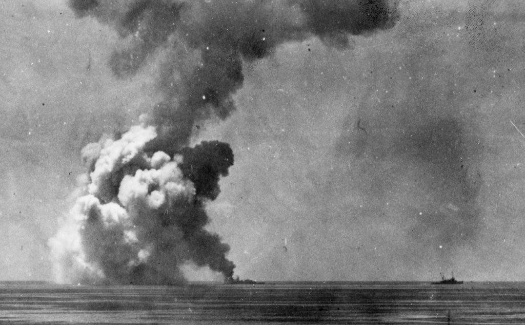 As Arikara draws away (right), the smoke from the magazine explosion dissipates to show that everything forward of number one stack has disintegrated. (U.S. Navy Photograph 80-G-333684, Lt. Ridgway Sutton, USNR, National Archives and Records Administration, Still Pictures Division, College Park, Md,)
