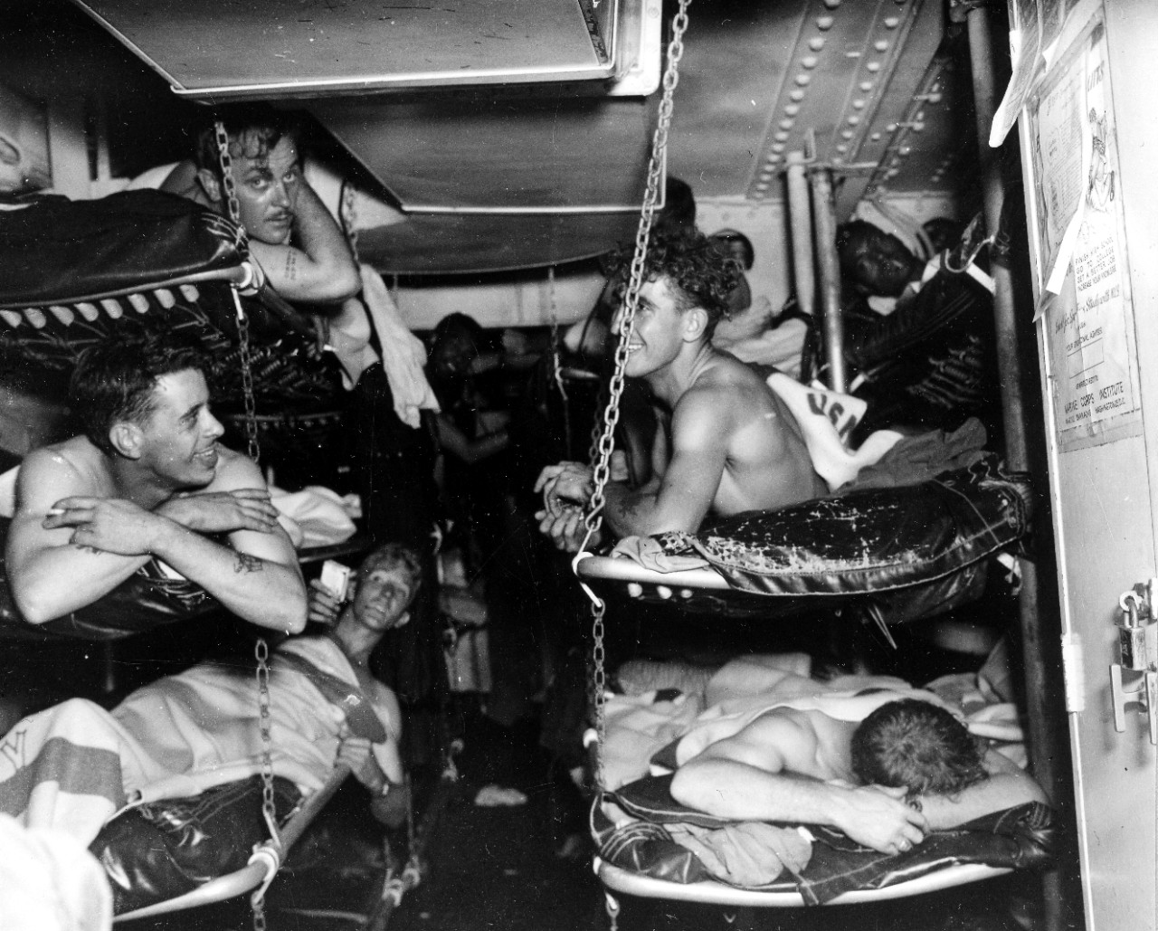 Longshaw's sailors relax on board Salt Lake City, 18 May 1945, showing various emotions after their ordeal. (U.S. Navy Photograph 80-G-343592, National Archives and Records Administration, Still Pictures Division, College Park, Md.)