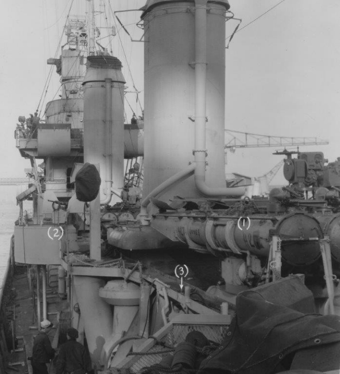 Looking forward along Madison's port side, New York Navy Yard, 1 January 1944. The numbers in parentheses indicate modifications to (1) the torpedo tube foundations and (2) 20-millimeter gun platform, while (3) indicates the installation of a catwalk and stanchions on the port side. The torpedo tubes may have been earmarked for installation on board Hilary P. Jones (DD-427) because of the prominent markings: 427  JONES   427. (U.S. Navy Bureau of Ships Photograph BS 59095, National Archives and Records Administration, Still Pictures Branch, College Park, Md.)