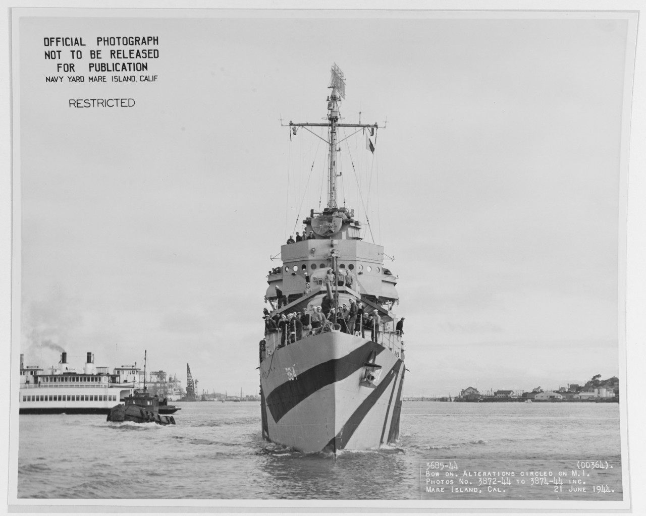 Bow-on view of Mahan, taken at Mare Island Navy Yard on 21 June 1944. Note the camouflage pattern carried around the stern in a continuous pattern. (U.S. Navy Bureau of Ships Photograph 19-N-67750, National Archives and Records Administration, Still Pictures Division, College Park, Md.)