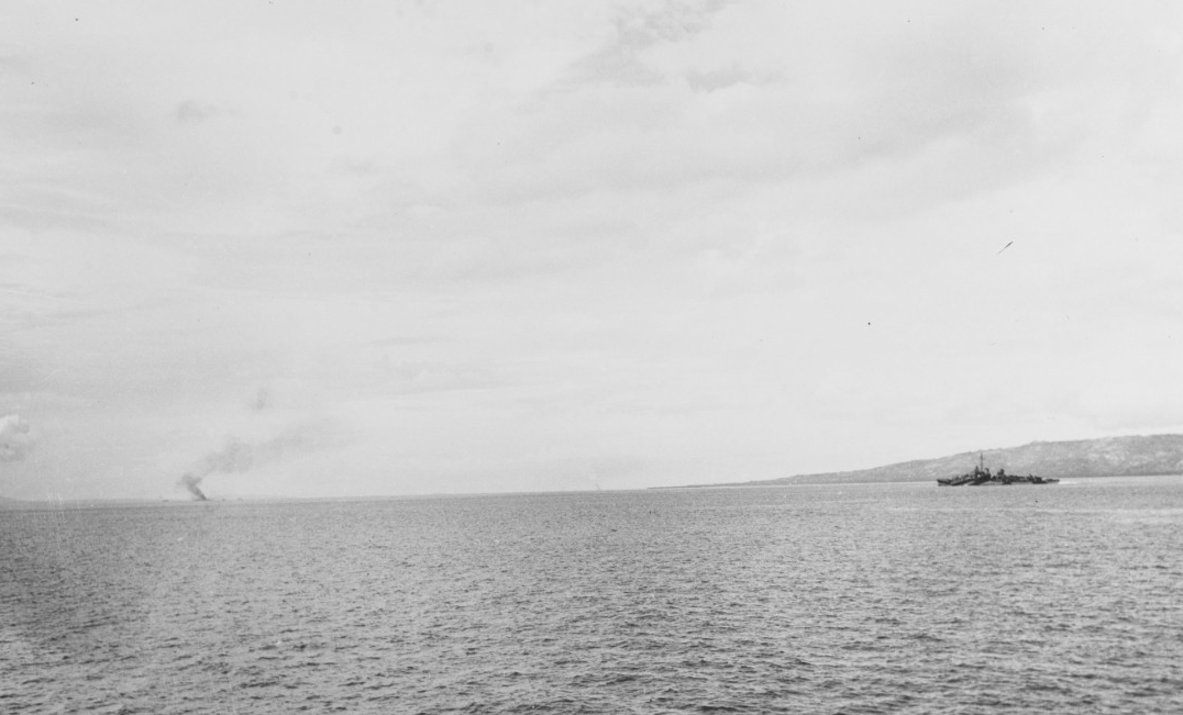 Mahan and Ward (APD-16) burning in the distance, during the landings at Ormoc, Leyte, Philippines, on 7 December 1944. Both ships received hits by kamikazes. (U.S. Navy Photograph 80-G-321974, National Archives and Records Administration, Still Pictures Division, College Park, Md.)
