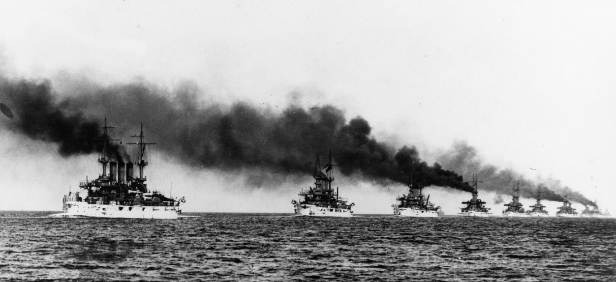 The Great White Fleet steams in column from Hampton Roads, Va. at the beginning of their cruise around the world, 16 December 1907. Kansas (left) and Vermont (next in line) lead the ships in this C. E. Waterman image. (Naval History and Heritage Command Photograph NH 92091)