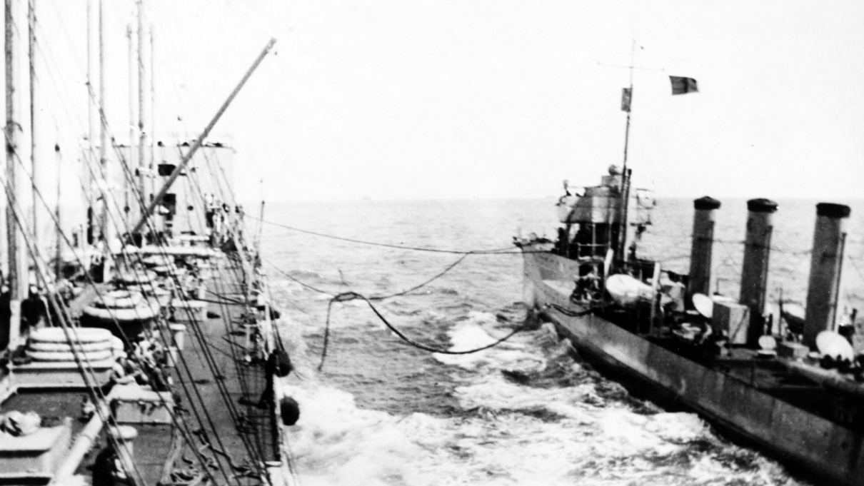 "Maumee replenishes McCall's fuel bunkers, 22 September 1917. Note the red ""Baker"" refueling flag flying from the destroyer. (Naval History and Heritage Command Photograph NH 93098)"