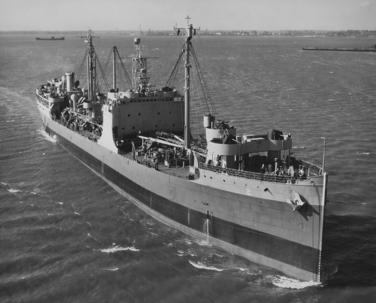 Riding high in the water following her refit at Norfolk Navy Yard, Maumee in Hampton Roads, 31 March 1945. (U.S. Navy Bureau of Ships Photograph, 19-LCM Collection, Box 93, National Archives and Records Administration, Still Pictures Branch, College Park, Md.)