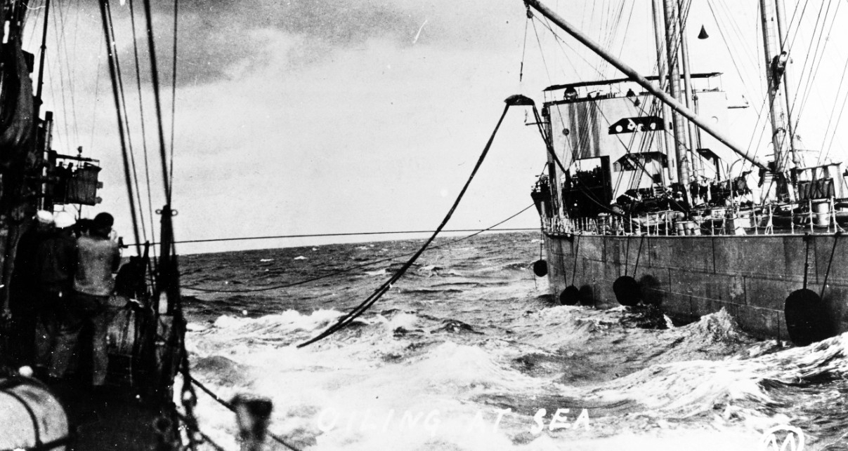 Warrington (Destroyer No. 30) oiling at sea during World War I, from either Kanawha (Fuel Ship No. 13) or Maumee. (Courtesy of Gustavus C. Robbins, Somerville, Mass., 1973, Naval History and Heritage Command Photograph NH 77154)