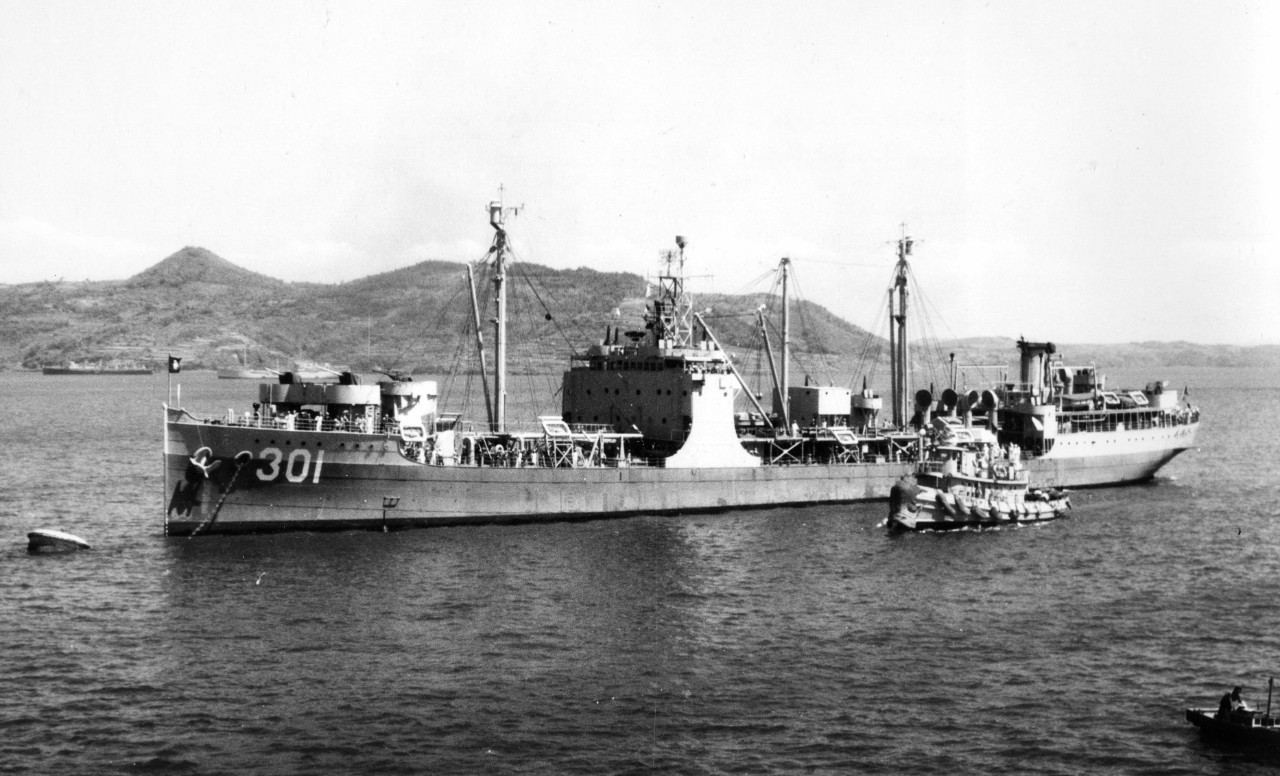 Painted in a graded scheme reminiscent of that worn during her time in the U.S. Navy during World War II, Omei (AO.301), ex-Maumee, lies moored to a buoy at Sasebo, Japan, on 1 July 1951, as seen from escort carrier Sicily (CVE-118). (U.S. Navy Photograph 80-G-436782, National Archives and Records Administration, Still Pictures Branch, College Park, Md.)