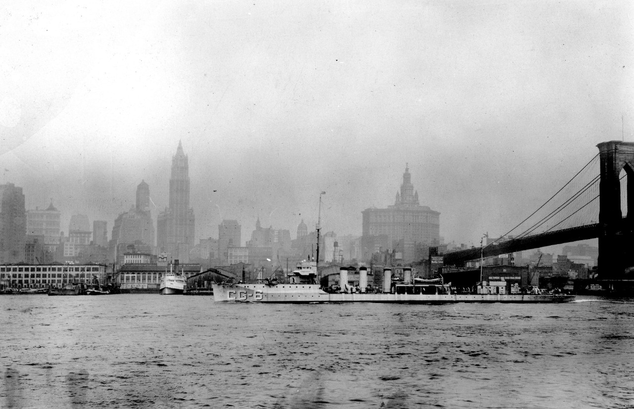 McDougal passes underneath the Brooklyn Bridge en route from the New York Navy Yard (Official U.S. Coast Guard Photograph, U.S. Coast Guard Historian's Office, McDougal file)