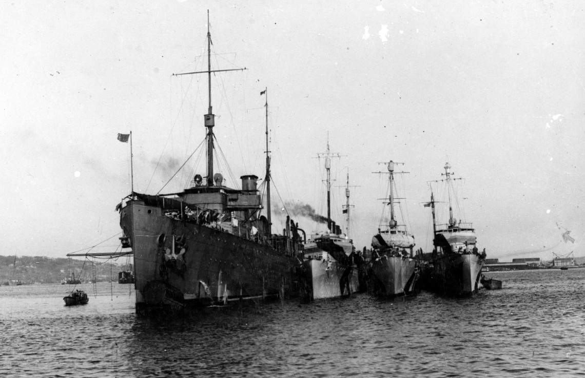 Melville lies at Queenstown, Ireland, with a trio of destroyers alongside in 1918, when British First Sea Lord Adm. Sir Rosslyn E. Wemyss, RN, visits the U.S. ships. The ships are painted in the wartime dazzle scheme but Melville's is faded, mute testimony to the rigors of her deployment. (Naval History and Heritage Command Photograph NH 46397)