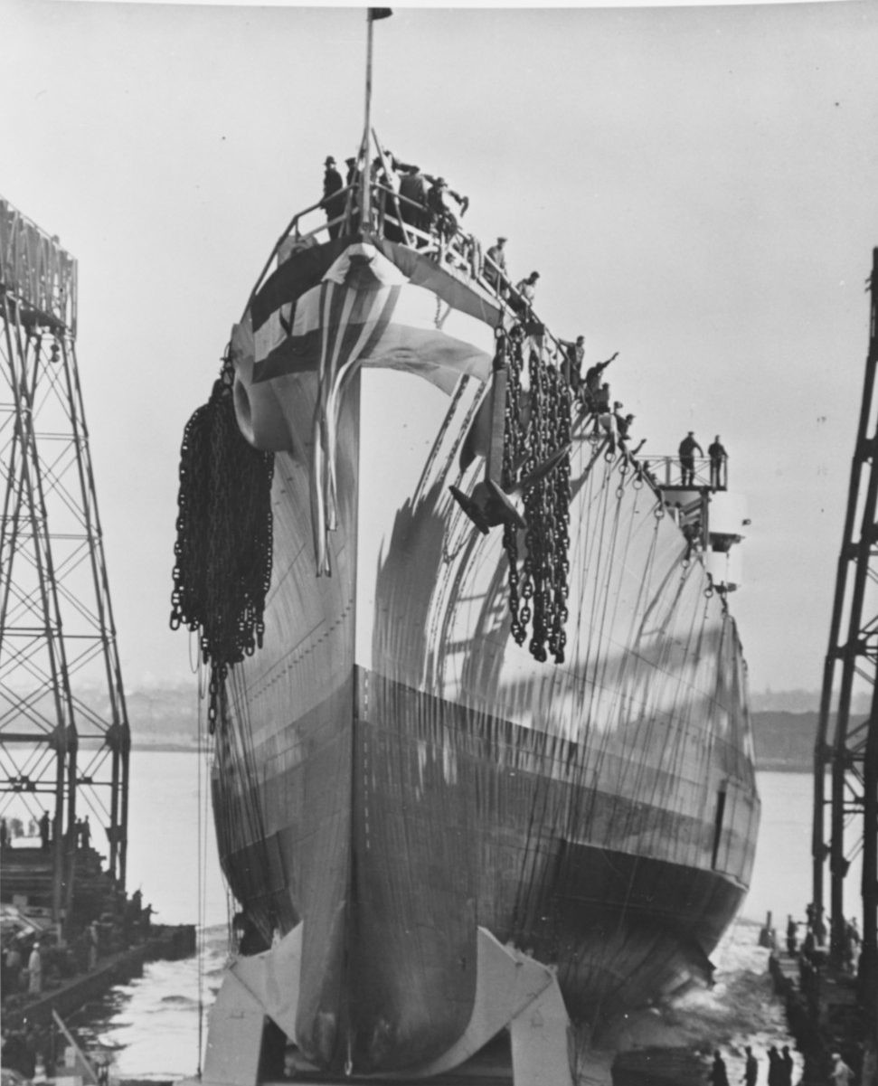 Launching of Miami at Philadelphia, Pa., on 8 December 1942. Note the anchors and chains at the ship's bow, positioned in preparation for stopping her once she moves out into the water. (Naval History and Heritage Command Photograph NH 75601)