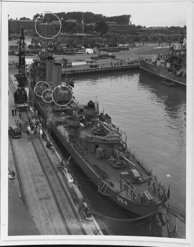 Monaghan moors at Mare Island Navy Yard, 13 October 1942. Note the details of the early model 5-inch mounts aft. The circles point out the modifications just made to the destroyer. Ralph Talbot (DD-390) is in the background. (U.S. Navy Bureau of Ships Photograph 19-N-35831, National Archives and Records Administration, Still Pictures Branch, College Park, Md.)