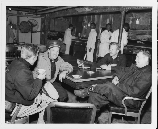 Capt. Bertram J. Rodgers (right), Salt Lake City's commanding officer, his executive officer, and navigator, and Monaghan's torpedo officer, relax in the cruiser's wardroom and discuss the battle at Dutch Harbor, Alaska, after the action. (U.S. Navy Photograph 80-G-50209, National Archives and Records Administration, Still Pictures Branch, College Park, Md.)
