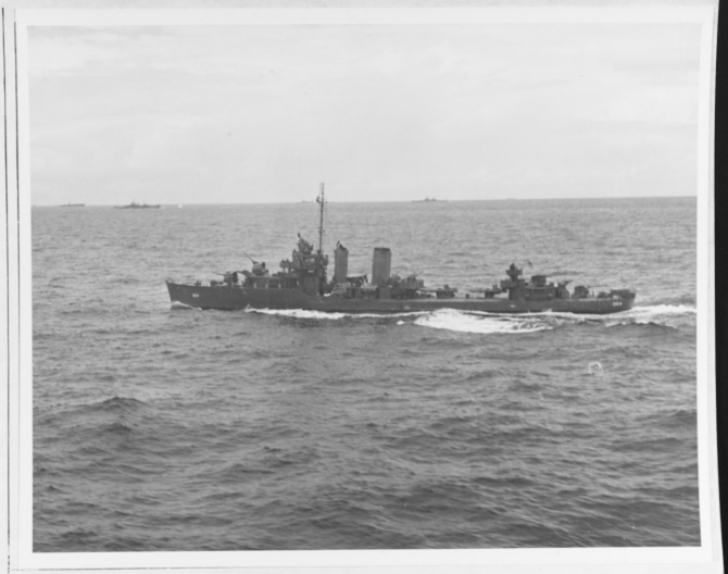 Monaghan at sea, May 1944. Note her distinctive twin stacks and mainmast. (U.S. Navy Photograph 80-G-376093, National Archives and Records Administration, Still Pictures Branch, College Park, Md.)
