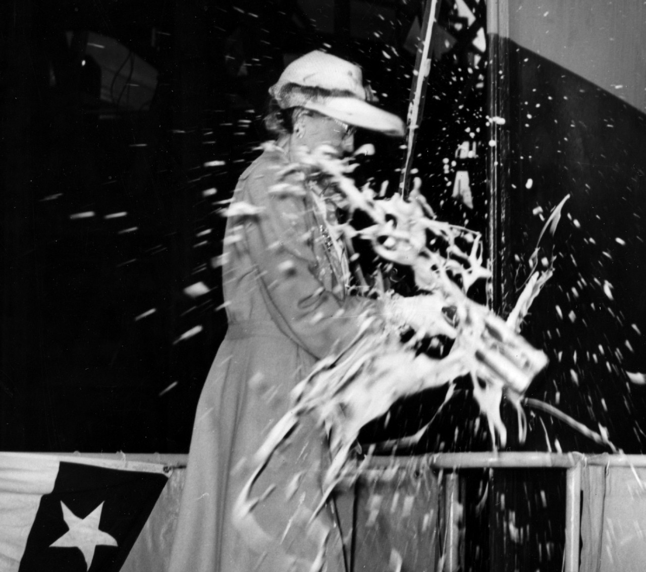 Coxswain Morrison's daughter christens the destroyer named for her father on Independence Day 1944. (U.S. Navy Photograph 80-G-77842, National Archives and Records Administration, Still Pictures Division, College Park, Md.)