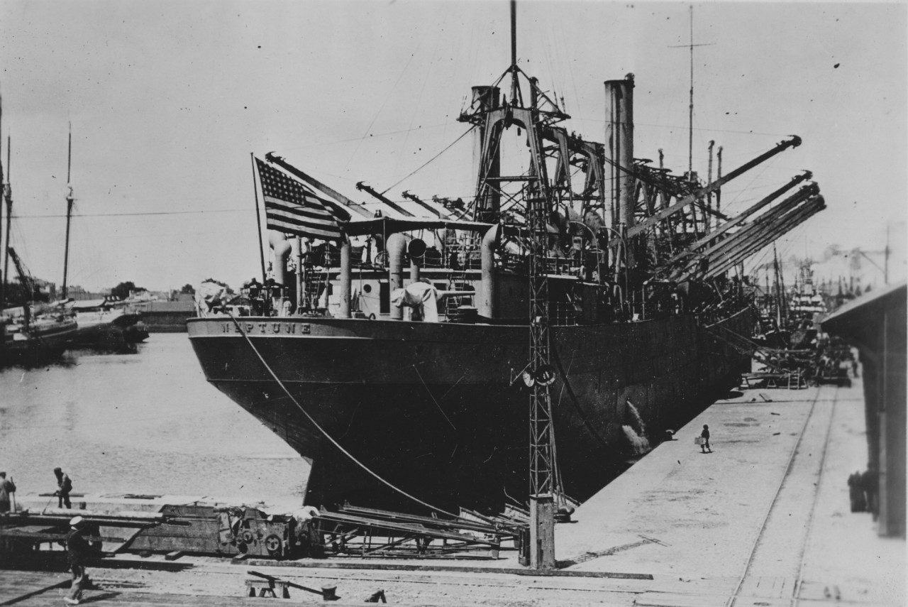 Neptune, her name clearly emblazoned on her stern in raised steel letters, lies moored at St. Nazaire, France, in June 1917. (U.S. Army Signal Corps Photograph 111-SC-95451, National Archives and Records Administration, Still Pictures Branch, College Park, Md.)