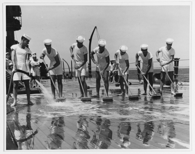 The seven Patten brothers man the brooms for clean-up detail, circa September 1941. From left to right: Bruce, Ray, Allen, Myrne, Clarence, Jr., Marvin, and Gilbert. (Naval History and Heritage Command Photograph NH 51886)