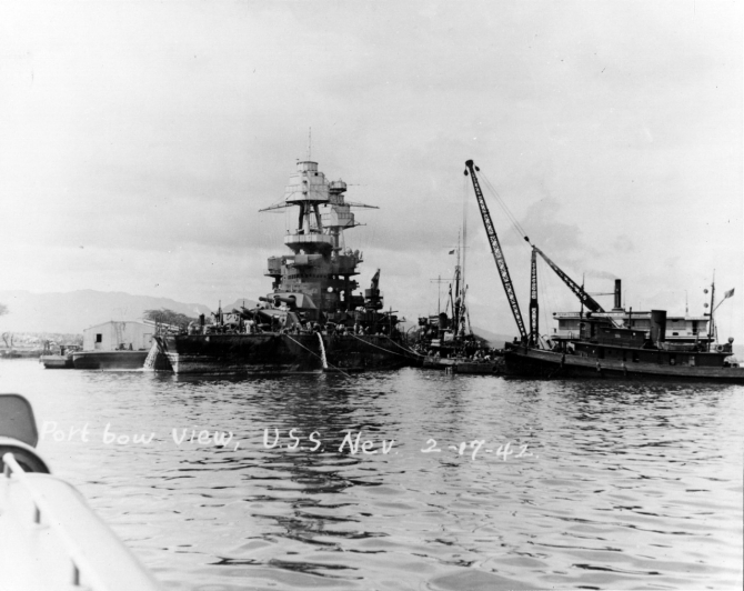 The Hawaiian Dredging Company crane barge Gaylord and other ships assist Nevada as she is prepared for drydocking at the Pearl Harbor Navy Yard, 17 February 1942. Collection of Vice Adm. Homer N. Wallin. (Naval History and Heritage Command Photograph NH 50106)