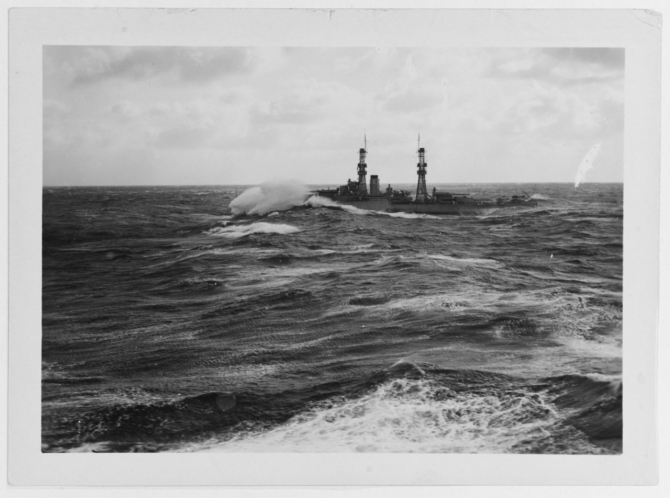 "Nevada underway in 1925. ""No we're not sinking, we'll come up again. This is a moderately heavy sea."" Courtesy of Captain F. Kent Loomis, USN (Ret.), Assistant Director of Naval History. (Naval History and Heritage Command Photograph NH 63646)"