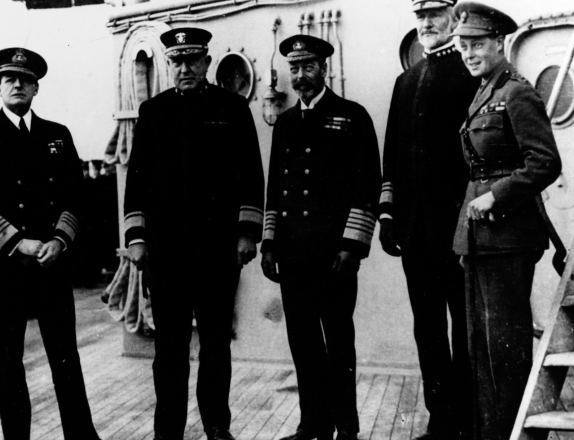 Left to right, Adm. David Beatty, RN; Rear Adm. Rodman; King George V; Vice Adm. William S. Sims; and the Prince of Wales (later King Edward VIII) on board New York, 20 November 1918. Courtesy of Treasure Island Museum, 1976. (Naval History and Heritage Command Photograph NH 85818)