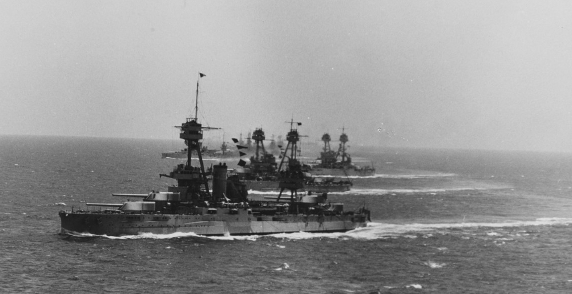 Eight battleships at sea during winter maneuvers of the joint U.S. fleets, circa 1930. New York is in the foreground. (Naval History and Heritage Command, NH 73835)