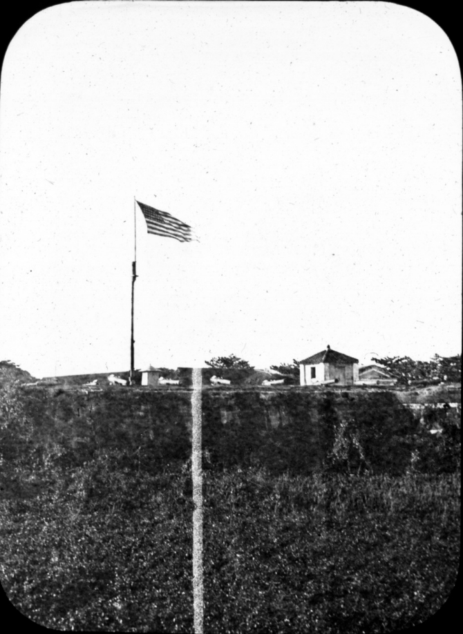 The Americans raise Olympia's flag over Manila, 13 August 1898. (Donated by the estate of Lt. C.J. Dutreaux, unattributed or dated U.S. Navy Photograph WHI.2014.38, Photographic Section, Naval History and Heritage Command)