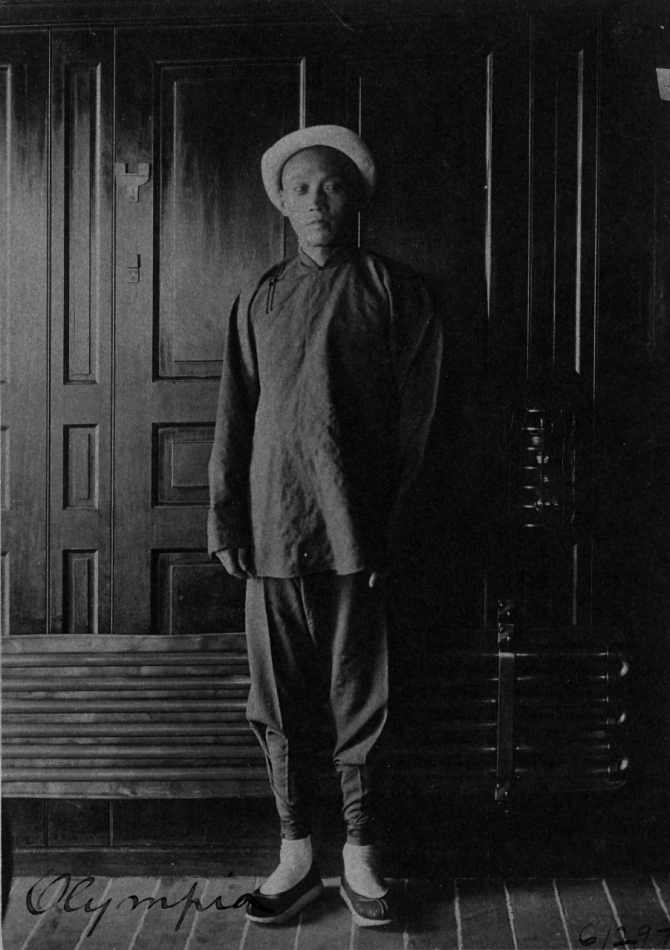 A Chinese steward on board the ship wears traditional dress, c. 1898. (George Grantham, Cyanotype print, U.S. Navy Photograph NH 43215, Photographic Section, Naval History and Heritage Command)