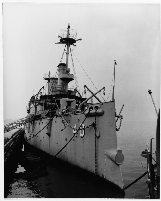 The stripped-down ship rests serenely at her moorings at Philadelphia Naval Shipyard, 1957. (Courtesy of the Cruiser Olympia Association, 17 January 1958, U.S. Navy Photograph NH 43278, Photographic Section, Naval History and Heritage Command)
