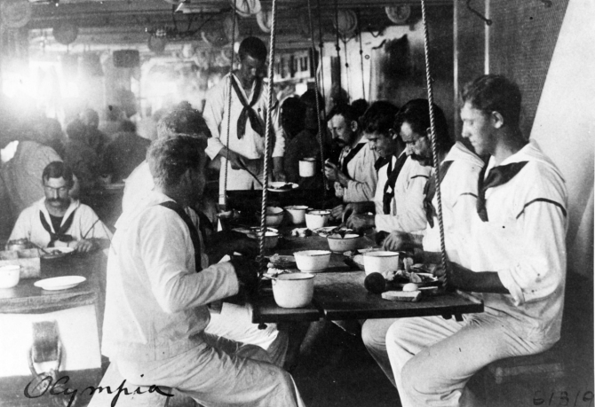 Sailors of the ships company eat at their mess, c. 1898. (Unattributed or dated U.S. Navy Photograph NH 60779, Photographic Section, Naval History and Heritage Command)